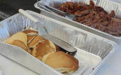 Rotarians serve the community some Saint Patty pancakes