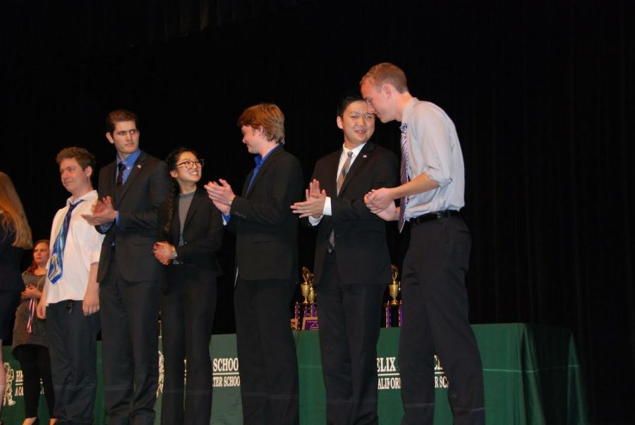 Members+of+Carlsbad+High+School%27s+nationally+ranked+speech+and+debate+team+stand+on+stage+waiting+to+accept+awards+for+the+events+that+they+placed+in.