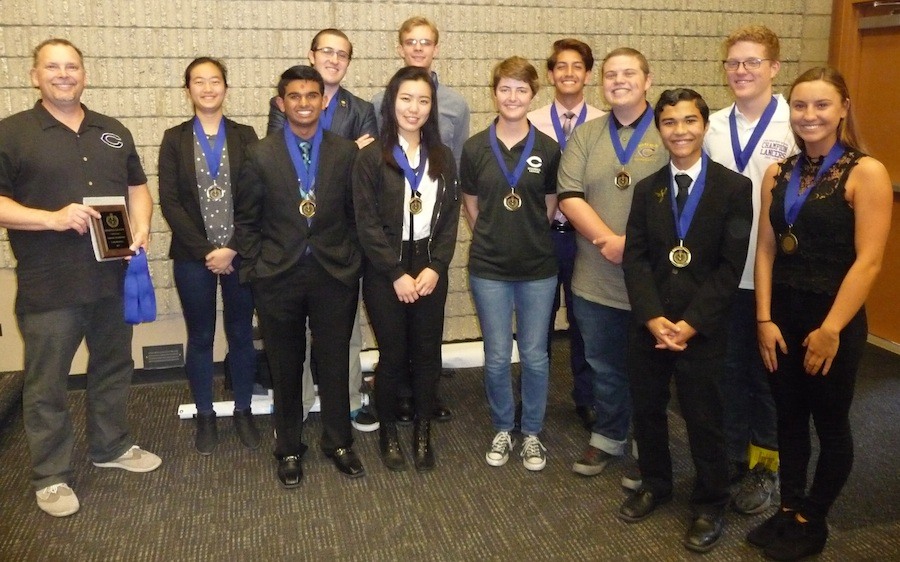 The varsity Academic League team poses with their medals for winning the Coastal Division.