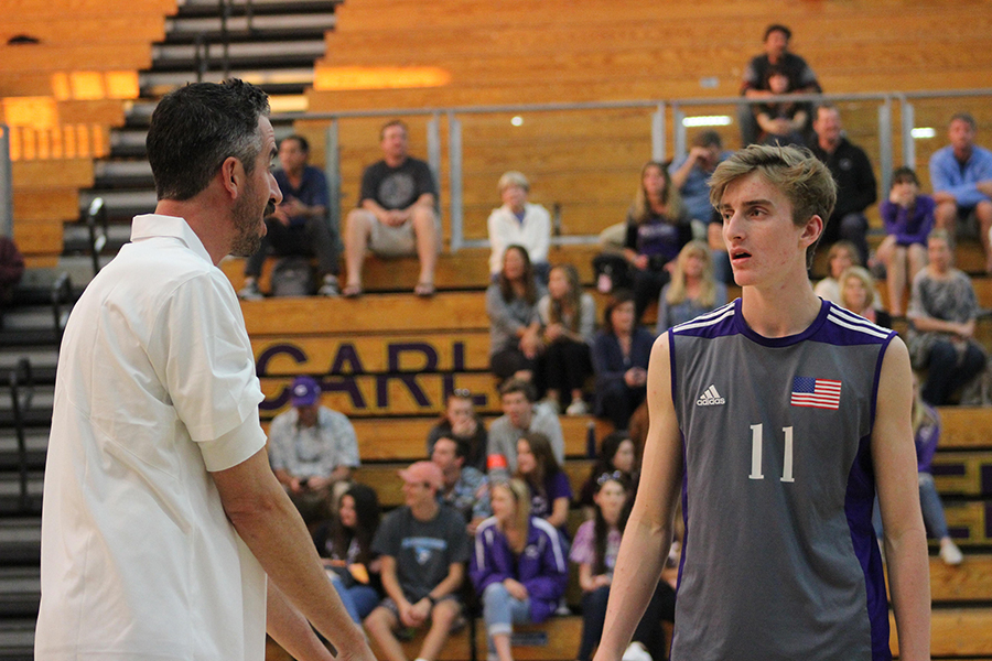 During a break in play, senior Devin Van Siclen gets some pointers from Coach Tomkinson on the sidelines. Van Siclen is new to the varity squad this season but his 6'5