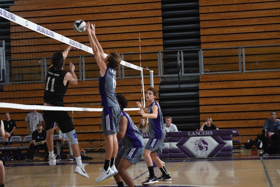 Senior+Kaden+Rutherford+blocks+a+Pacific+Ridge+attempt+to+score+a+point.+The+Lancers+won+in+three+games+over+the+Firebirds.