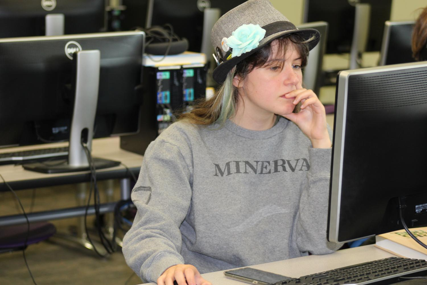Corin Magee, 12, works on her coding program in Saied Moezzi's computer science class.