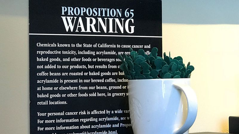 Coffee+shops+used+to+be+required+to+warn+customers+of+their+risk+of+cancer.+