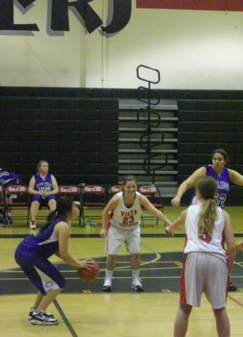 Due to a foul, a member of the Carlsbad team makes a free throw
