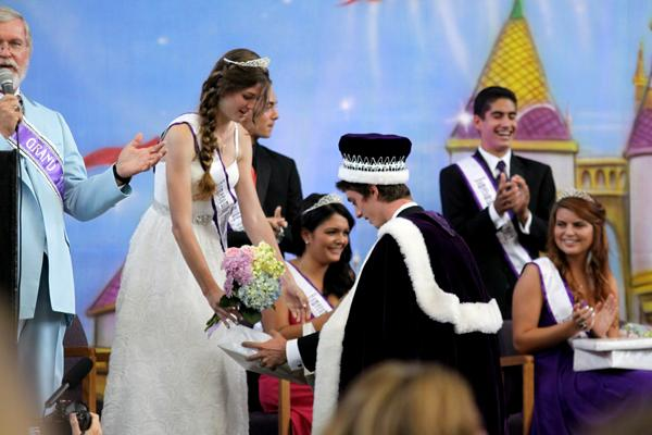 Homecoming King Scott Snow, helps Homecoming Queen Seannie Bryan, put on her slipper just moments after she realized she had won. (credit: Jared Cohn)