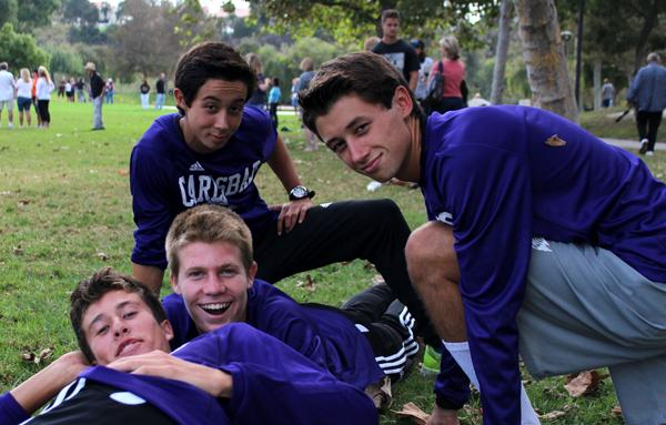Brothers Christian and Kevin Freeman, (both kneeling) enjoy hanging with friends Jeff Schaffer and Shay Martin during their cross country meet against LCC. PC: Seannie Bryan