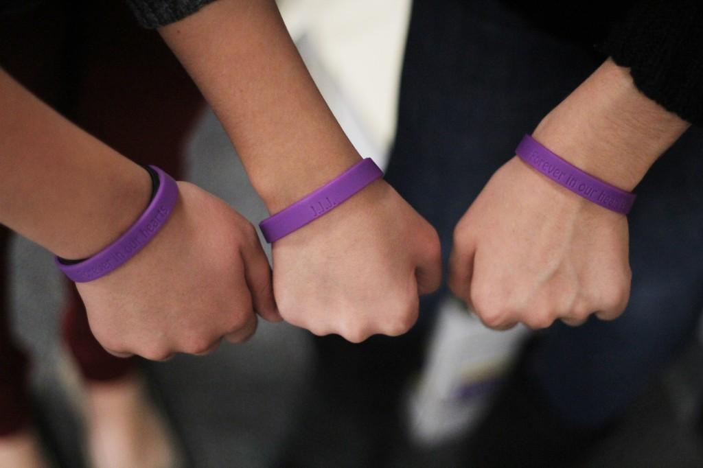 Interact club sells wristbands to commemorate Mr. Harper, support children