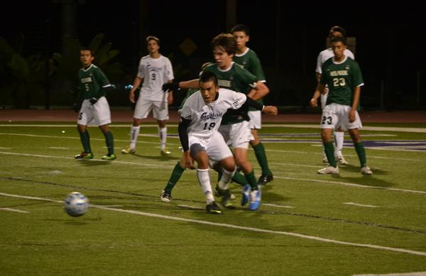 Senior Tito Cruz intercepts Oceanside player to get the ball and go down to the opponents' goal post.