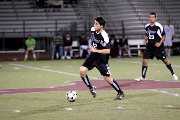 Senior Jared Marr dribbles the ball up the field to shoot on goal during a game against Rancho Buena Vista.