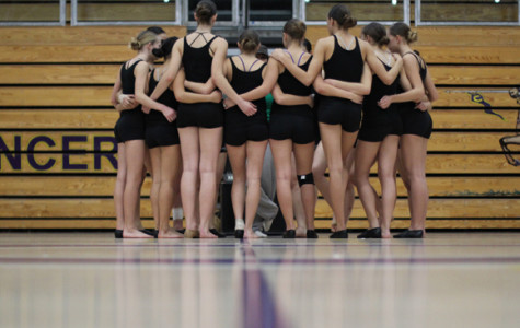 The Lancer Dancers prepare to perform their competition routine at the Friends and Family Showcase in the New Gym in preparation for their departure to the 2013 Nationals.