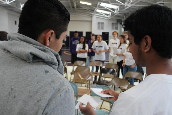 Eric Aviles and Nik Sharma look over some notes before the first PeerPLUS event this year.