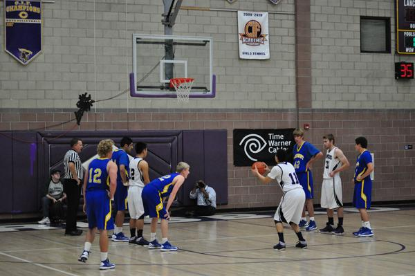 Senior Robert Reddick earned one of the multiple fouls during the CIF game. He contributed points to the final score 52-43 CHS.
