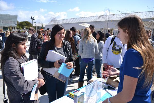 Junior Saira Salazar asked a couple questions to the representative of University Of Pennsylvania at Thursday's mini-college fair on the plaza. As a junior, She has many options to chose her future school.