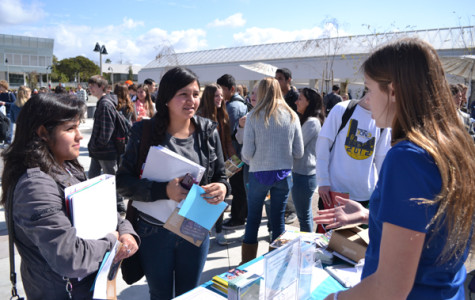 Students speak to college representatives at the mini-college fair held Thursday, Feb. 21, at lunch. Many colleges as well as the military were in the Plaza to help students consider their post-high school college and career plans.