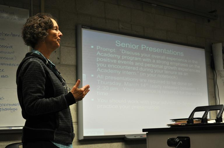 Science teacher Paige DeCino gives advice to Academy seniors on their end of the year senior presentations on Feb. 4.  Students will present the work they did as interns to a panel of teachers next month.