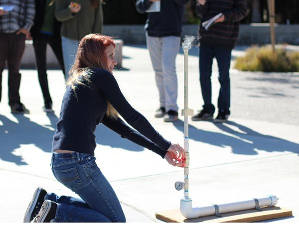 Sophomore+Megan+Ohlin+reacts+as+her+rocket+fails+to+launch+off+the+platform.+On+Wednesday%2C+Feb.+20%2C+Mr.+Alexander%27s+students+all+launched+their+rockets+for+their+latest+physics%27+project.+
