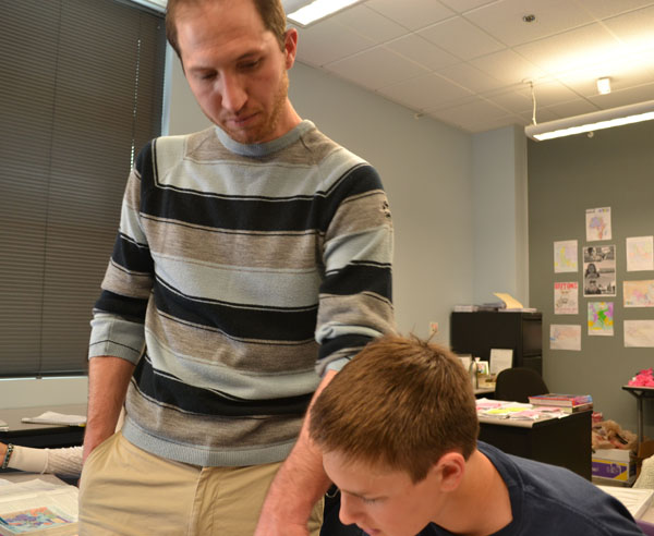 Mr. Shinnefield helps out his student, Hunter Padgett on their current unit section on World War 2.