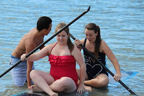 On Saturday many Carlsbad students went to the Carlsbad Lagoon to support CHS alumni, Hunter Chanove as he was recently diagnosed with a rare form of cancer in his right eye. His younger brother Conner Chanove assists seniors Elyse Ruane and Emma Stringer in getting aboard a paddle board.