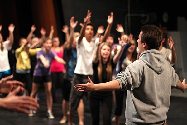 Lead actor junior Evan Ridpath rehearses after school during the casts second choreography rehearsal.