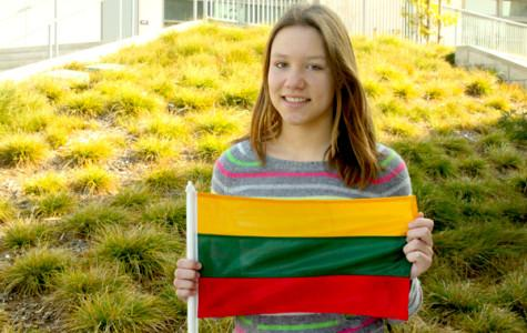 Gabija Grigonyte poses with the Lithuanian flag. Grigonyte was born in Lithuania, a country near Poland and Latvia, but moved to the United States when she was four years old.