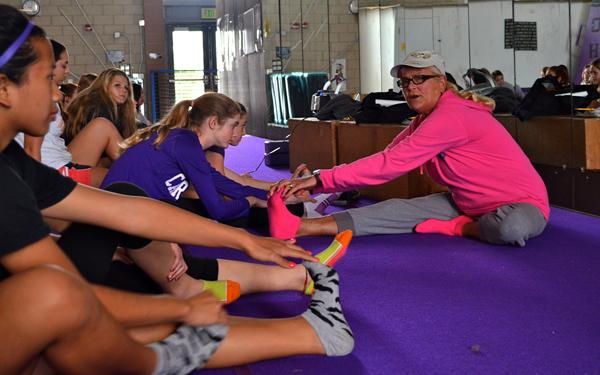 Jane McGhee instructs her freshmen students in power stretching before their mile. McGhee celebrated her 40th year teaching at Carlsbad High School on Feb. 5.