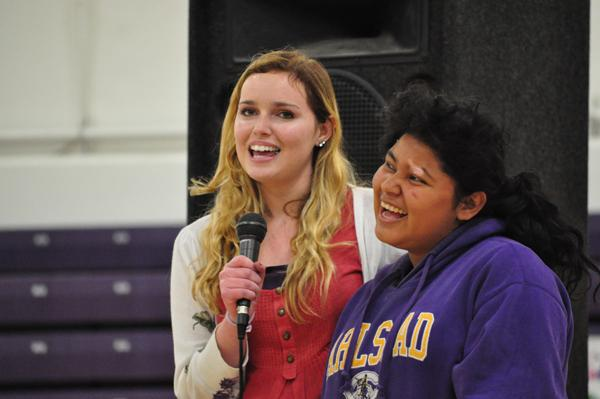 Junior Indira Rodway enjoys the assembly with her buddy as the open the show with