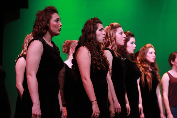 Senior Alex Miller sings with fellow members who will also be going to New York on March 20 to perform under Eric Whitacre. All levels of choir performed at the Night With the Stars on March 7 and 8 in the CAC.