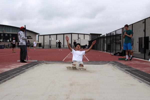 Senior Micheal Pacanos practices for the long jump. He hopes to break his own personal record every time he jumps.