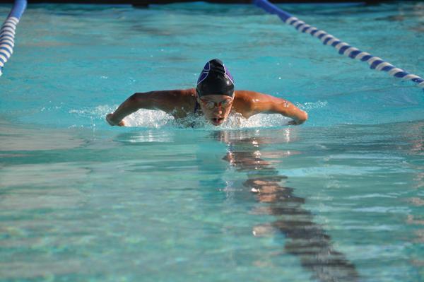 Freshman Mani Mendez swims 100 meters during the El Camino swim meet. As a freshman, Mendez is very proud to be a varsity swim member.