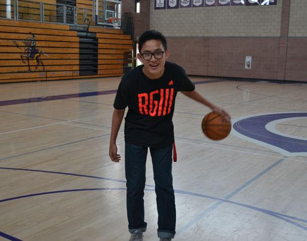 Junior, Sean Deng practices his dribbling skills.