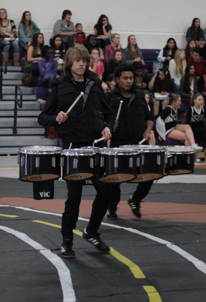 Junior Cole Pennick performs with the rest of drumline at the Best of the Best assembly on March 22. Drumline performed along with Lancer Dancers, Xcalibur, and cast members of Singing in the Rain, also several sports were recognized for their outstanding season such as girls and boys varsity soccer and boys varsity water polo.