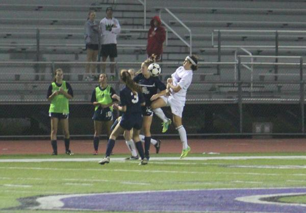During their season, varsity girls soccer took on San Marcos High at home, winning the game 4-1. Junior Sophie Zlotnicki tries to regain control of the ball during the game.