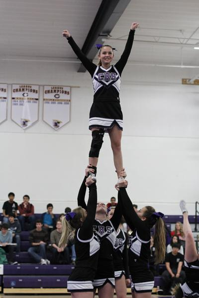 The Carlsbad Competition Cheer team performs at the assembly.