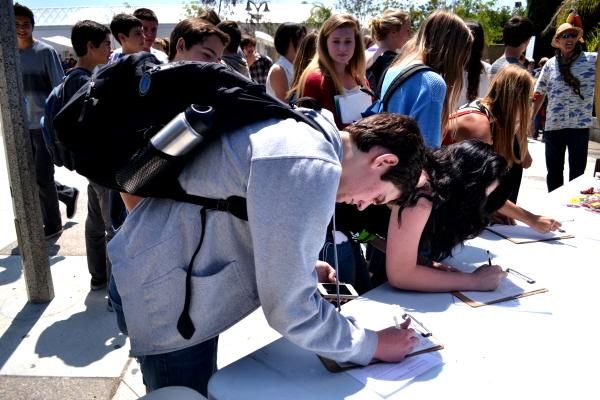 Junior Sam Krimmer signed a petition which is a vow to clean the environment. On April 22, Earth day was celebrated at CHS and the Green Club set up recycling bins  to recycle plastic water bottles and make CHS greener than ever.