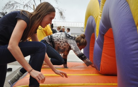 Sophomores Keira Dagy and Cassidy Mayer were many of the pairs to file through the Grand Canyon University obstacle course Wednesday at lunch. As a promotion, GCU brought a giant, inflatable, obstacle course and allowed students to race each other. The winner of each race received purple