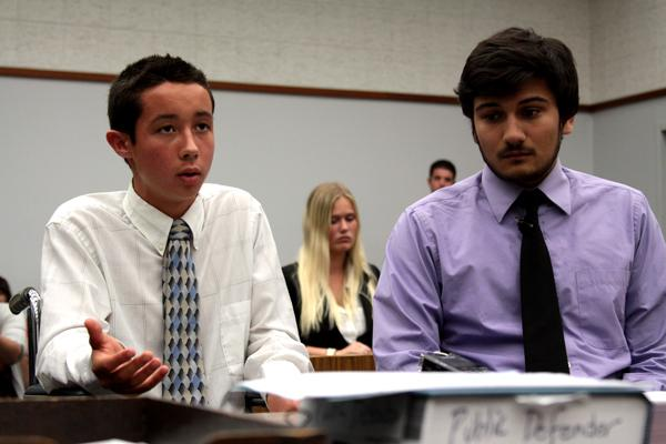 Junior Isaac Brieske listens as junior Christian Freeman requests leniency for Brieske from the judge.  Freeman was paralyzed in the accident.