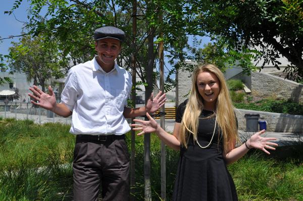 Seniors Sean Pruett and Jackie Eghtesadi show us their jazz hands after a blast into the 1920's. Part of the prom spirit week is to dress as a character from the 1920's and these two sure nailed it.