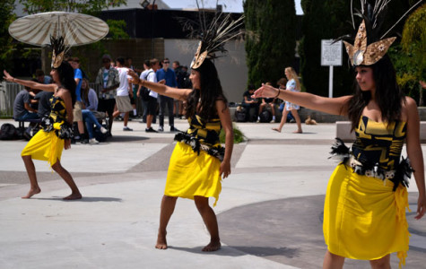 From bottom to up Seniors Leslie Calas, Bibiana Mejia and, Alondra Lua performed a Polynesian dance on May 3 during lunch. For Hawaiian day, their coach showed the school the culture of Hawaii.