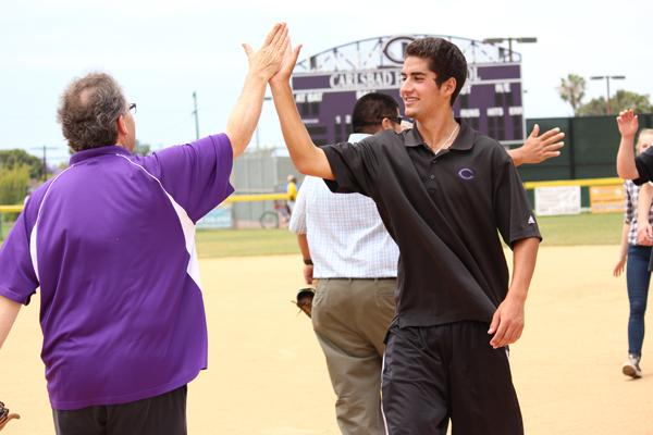 Senior Nick Romero and Sean Jones high five each other after the Over the Line game where ASB put up a fight, but the teachers came out with the win.