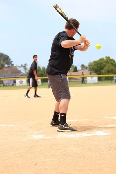 Senior Brian Thompson gets ready to hit the ball fellow senior Nick Romero pitched.