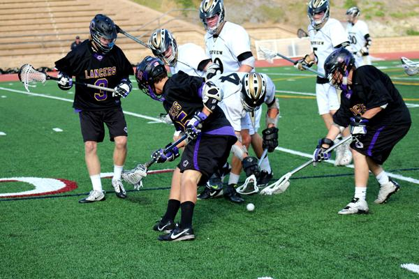 Senior Kevin Moyer (3) and juniors Teegan Willis (25) and Dylan Harris (4) battle for a ground ball against Westview in the third quarter of the Division I San Diego Championship.