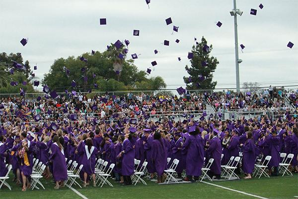 After the Class of 2012 graduated last year, the annual tossing of the caps occurred. The sky was filled with purple over a sea of newly-graduated high school students.