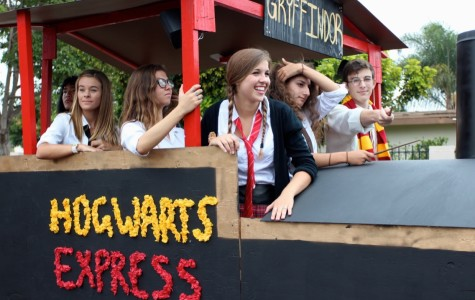 CHS senior's ride the Hogwarts Express during the annual Lancer Day Parade. Decked out in Harry Potter gear, these students wear red and gold to represent Gryffindor.