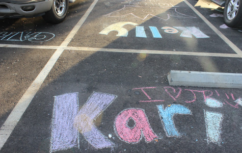 Seniors use chalk to write their names and reserve spots all throughout the parking lot.  Throughout the course of the day, some were smeared, but students were quick to fill them back in.