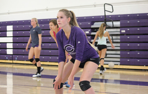 Varsity volleyball player Kasie Coogan prepares to pass to her teammate during warm ups at their 2 hour practice. The next girls game is this Wednesday at Santa Fe Christian, and a home tournament starts at CHS on Friday.