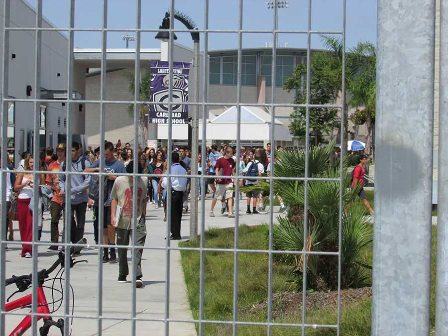 A new policy requires that all freshmen and sophomores stay on campus during lunch and the gates closed during break. Juniors and seniors must now show ID cards at the main gate to exit campus at lunch.