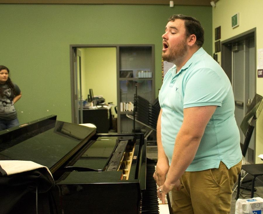 Mr. Bullock, a fresh new face to the CHS campus, leads the choir in warmups at the beginning of class. Many students are used to seeing Ms. Owen in the choir room, but at the end of last year she left school to travel to the Ukraine to teach students there.