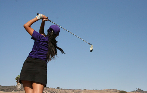 Maria Rojas, a third-year junior on varsity golf, practices her stroke. The girls on women's golf put in many hours in hopes to clench the CIF title.