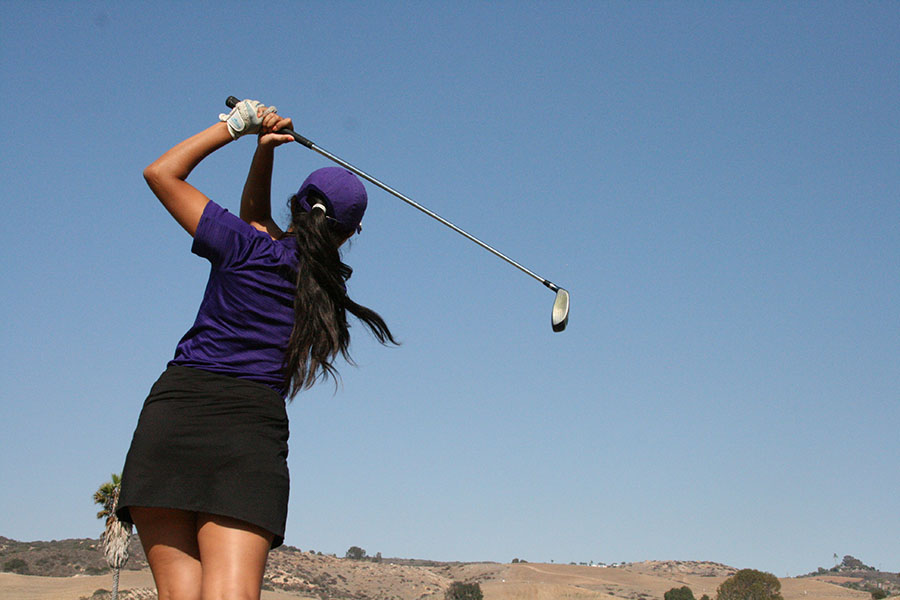 Maria+Rojas%2C+a+third-year+junior+on+varsity+golf%2C+practices+her+stroke.+The+girls+on+womens+golf+put+in+many+hours+in+hopes+to+clench+the+CIF+title.+