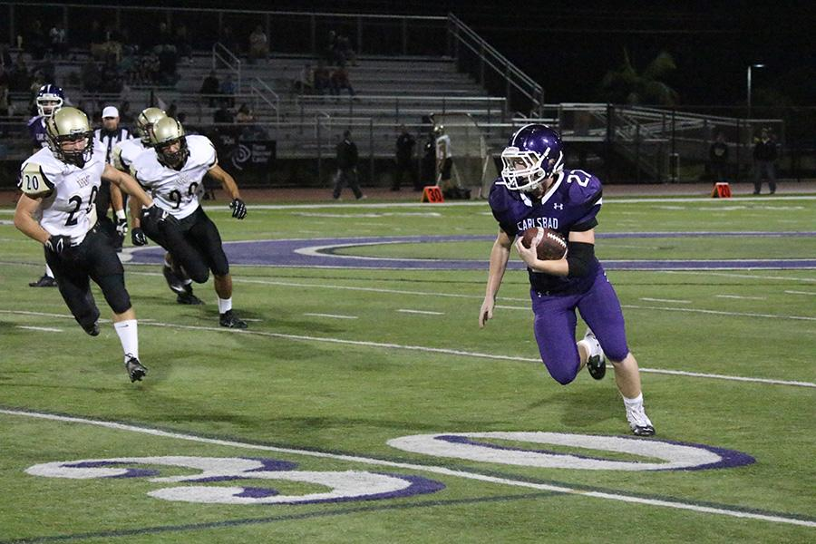 Varsity running back Dylan Rutledge scores at the Homecoming game. He contributed 3 touchdowns to the Lancer victory of 56-7.